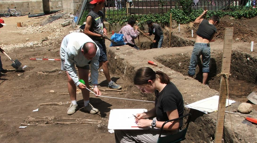 A group of Projects Abroad volunteers collecting data at an excavation site during their volunteer archaeology work in Romania.